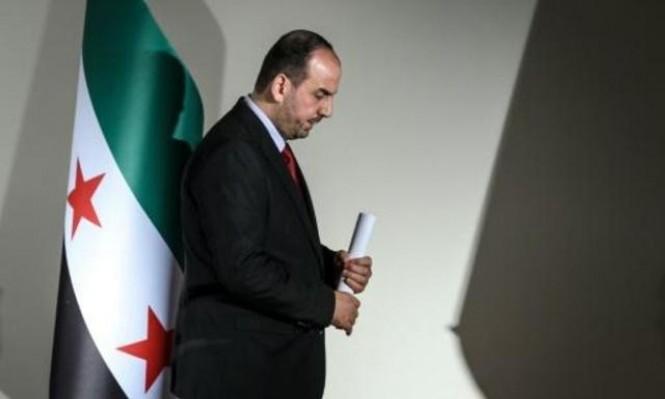 وفد المعارضة السورية لجنيف يتمسك برحيل الأسد