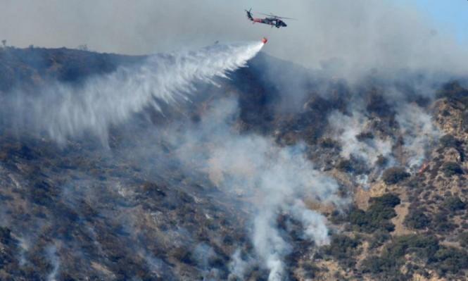 """طواقم الإطفاء تواصل جهود مكافحة حريق """" توماس """""""