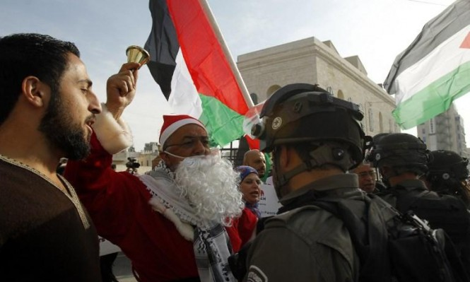 الاحتلال يقمع مسيرة الميلاد ببيت لحم وإصابات بغزة والضفة