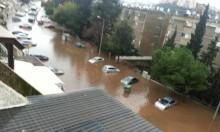 مياه الأمطار تتسبب بسيول وفيضانات وتغمر سيارات بحيفا وباقة