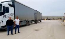 التجار يمتنعون عن توريد الشاحنات والبضائع لغزة