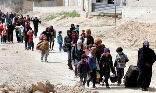 الغوطة: نزوح الآلاف ومفاوضات لوقف إطلاق النار