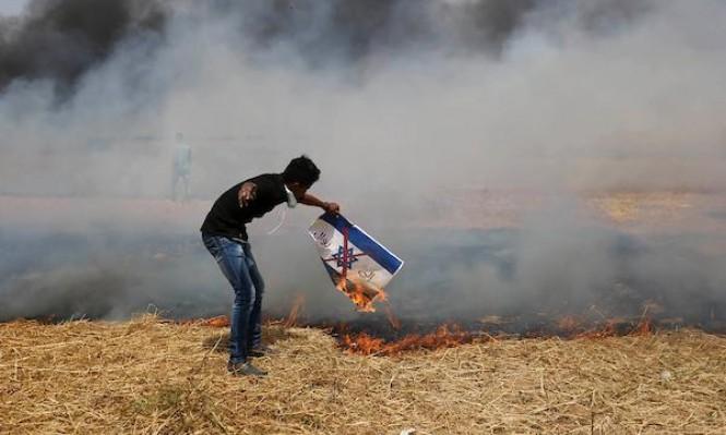 """غزة: جمعة """"رفع علم فلسطين وحرق علم إسرائيل"""""""