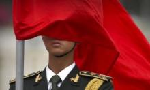 """منشورات تحذر الصينيين من """"الجواسيس"""" البيض"""