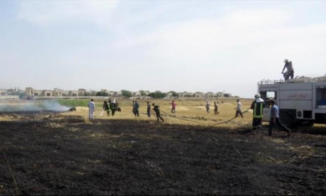 سورية: النظام يحرق الحقول الزراعية في ريفي إدلب وحماة