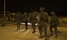 اعتقال 11 فلسطينيا بالضفة والاحتلال يغلق طريقا قرب رام الله