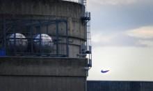 "نشطاء بيئيون يطلقون ""سوبر مان"" على مفاعل نووي فرنسي"