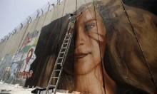 الاحتلال يطرد رسامين إيطاليين ويمنعهما من دخول البلاد