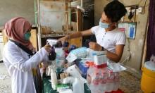 ممرضة وابنها يعالجان مصابين في احتجاجات البصرا