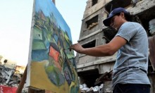 في مخيّم اليرموك، لاجئون فلسطينيّون يرسمون بين الأنقاض