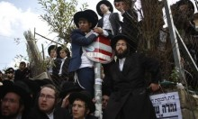 أوكرانيا: حجاج يهود يحرقون الصليب ويفرضون شعائرهم الدينية