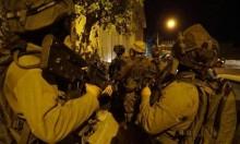 الاحتلال يعتقل 18 فلسطينيا ويضبط أسلحة بنابلس
