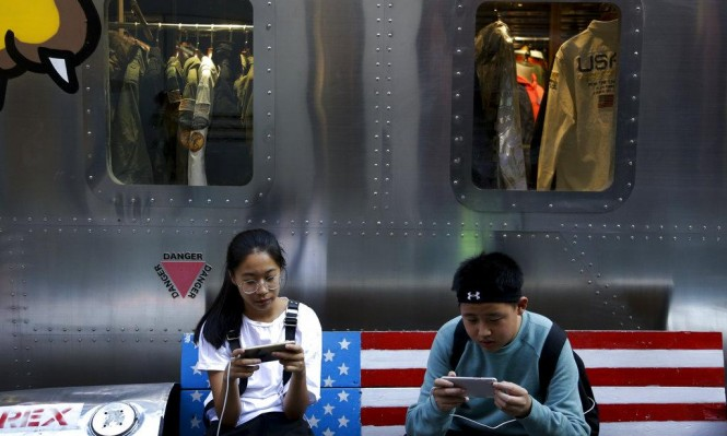 مسؤول صيني: على الولايات المتحدة إزالة السكين عن رقبتنا
