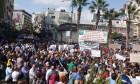 الآلاف يتظاهرون برام الله رفضا لقانون
