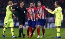 برشلونة وأتلتيكو مدريد مهددان بالعقوبة