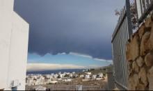 حالة الطقس: غائم جزئيا وأمطار محلية
