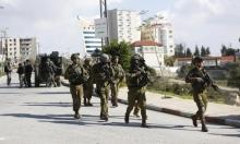 اعتقال عشرات الفلسطينيين بينهم نائبان وأسرى محررون