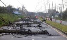 """""""بابوك"""" تتسبب بفيضانات وانقطاع الكهرباء وإجلاء الآلاف ومئات العالقين"""