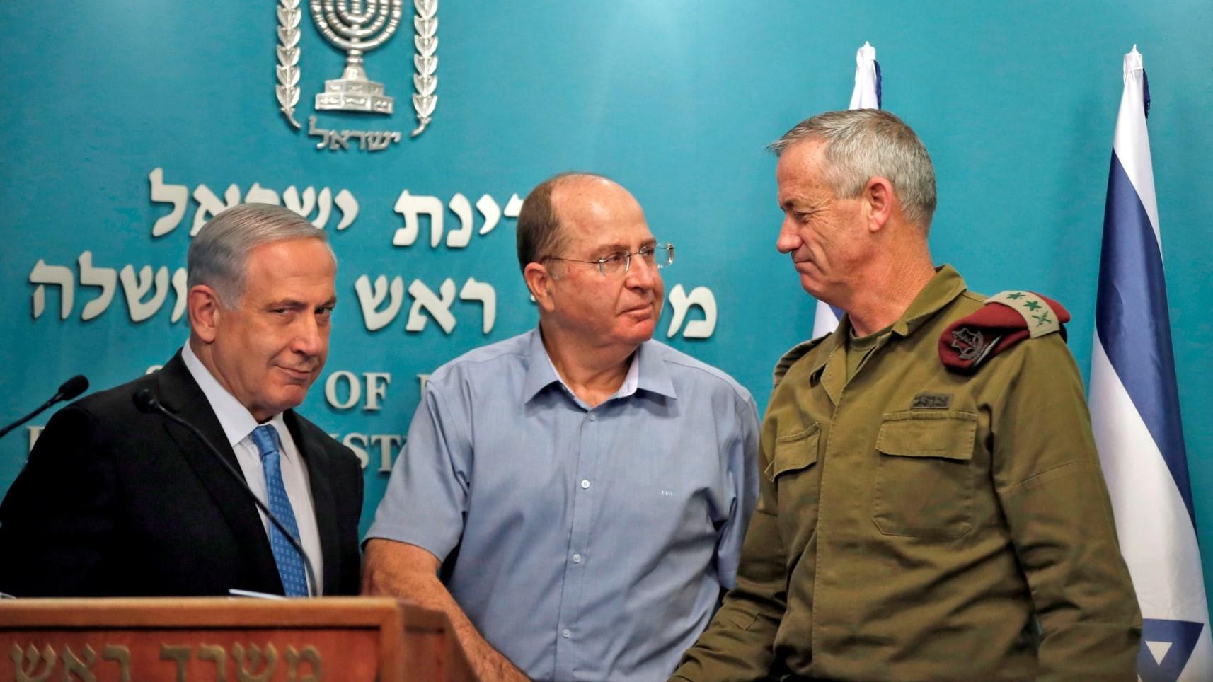 غانتس ونتنياهو ويعالون خلال الحرب على غزة (أ ف ب)