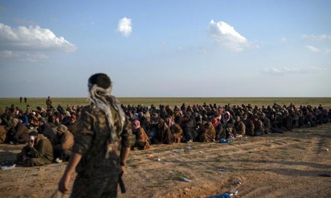 """3000 عنصر من """"داعش"""" سلموا أسلحتهم بالباغوز السورية"""