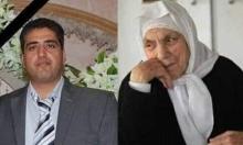 والدة فلسطيني أحد ضحايا مجزرة المسجدين تتوفى فوق جثمانه