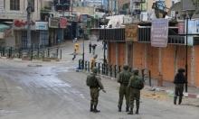 """اعتقال حارسين لفتحهما """"باب الرحمة"""" وإصابات بالاختناق بمدرسة بالخليل"""