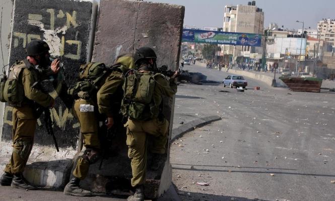 مخيم قلنديا: إصابتان بالرأس في مواجهات مع الاحتلال