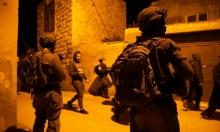 اعتقال 14 فلسطينيا بالضفة