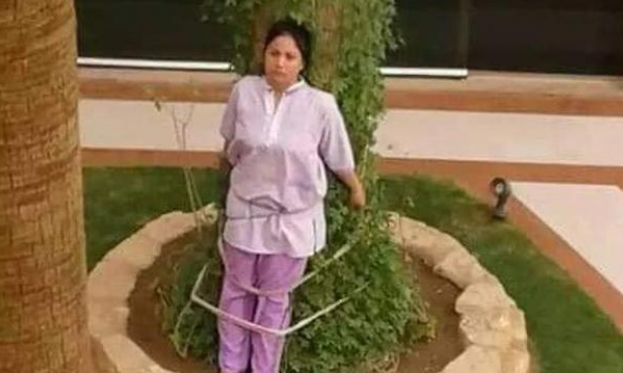 أسرة سعودية تقيّد عاملة منزل أجنبية في الفناء الخارجي