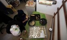 نساء غزّيّات يعددن كعك العيد