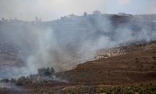 مستوطنون يحرقون مئات الأشجار بنابلس واعتقال 12 فلسطينيا بالضفة