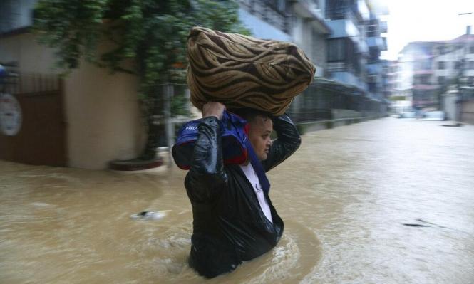 مصرع 50 شخصا على الأقل جراء الفيضانات بالنيبال