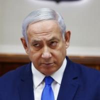 نتنياهو يتعهد بإعادة الإسرائيليين المحتجزين بغزة في حفل قاطعته عائلاتهم