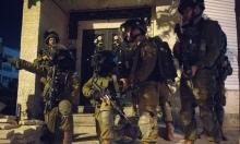 اعتقال 23 فلسطينيا بالضفة بينهم أسرى محررون