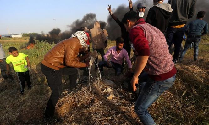 """إصابة 54 غزيا بجراح جراء قمع الاحتلال مسيرة """"الوفاء للشهداء"""""""