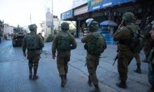 """اعتقال 11 فلسطينيا بالضفة واقتحام مكاتب """"الديموقراطية"""" برام الله"""