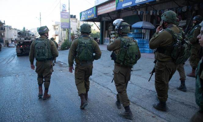 اعتقال 14 فلسطينيا بالضفة بينهم أسرى محررون