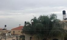 حالة الطقس: أجواء غائمة جزئيا مع فرصة لهطول أمطار