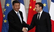 الصين تستقبل الرئيس الفرنسي وتحذره من التدخل بملف هونغ كونغ