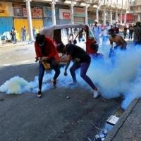 قتلى وعشرات الجرحى في قمع الأمن لاحتجاجات العراق
