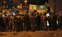 أنصار حزب الله وأمل يهاجمون متظاهرين في وسط بيروت