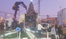 ترميم شجرتي الميلاد اللتين أُحرِقتا في جديدة المكر