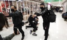 هونغ كنغ: اعتقال 12 متظاهرا ومطالب برحيل التجار الصينيين