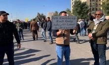 محيط السفارة الأميركية ببغداد: الحشد الشعبي يطالب المعتصمين بالانسحاب