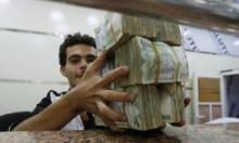 """اليمن: اقتصادان منفصلان و""""حرب"""" على الأوراق النقدية"""