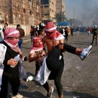 قتيلان وعشرات الجرحى بمواجهات مع الأمن في بغداد