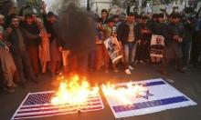 مصنع إيراني ينتج أعلام أميركا وإسرائيل لحرقها في المظاهرات