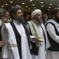 الولايات المتحدة وطالبان توقعان اتفاقا تمهيديا لحل النزاع
