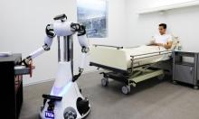 """كورونا: الروبوت """"تومي"""" يساعد الأطباء في إيطاليا"""