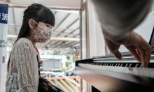 بتعلم الموسيقى في الشاحنات: الصين تتغلب على كورونا